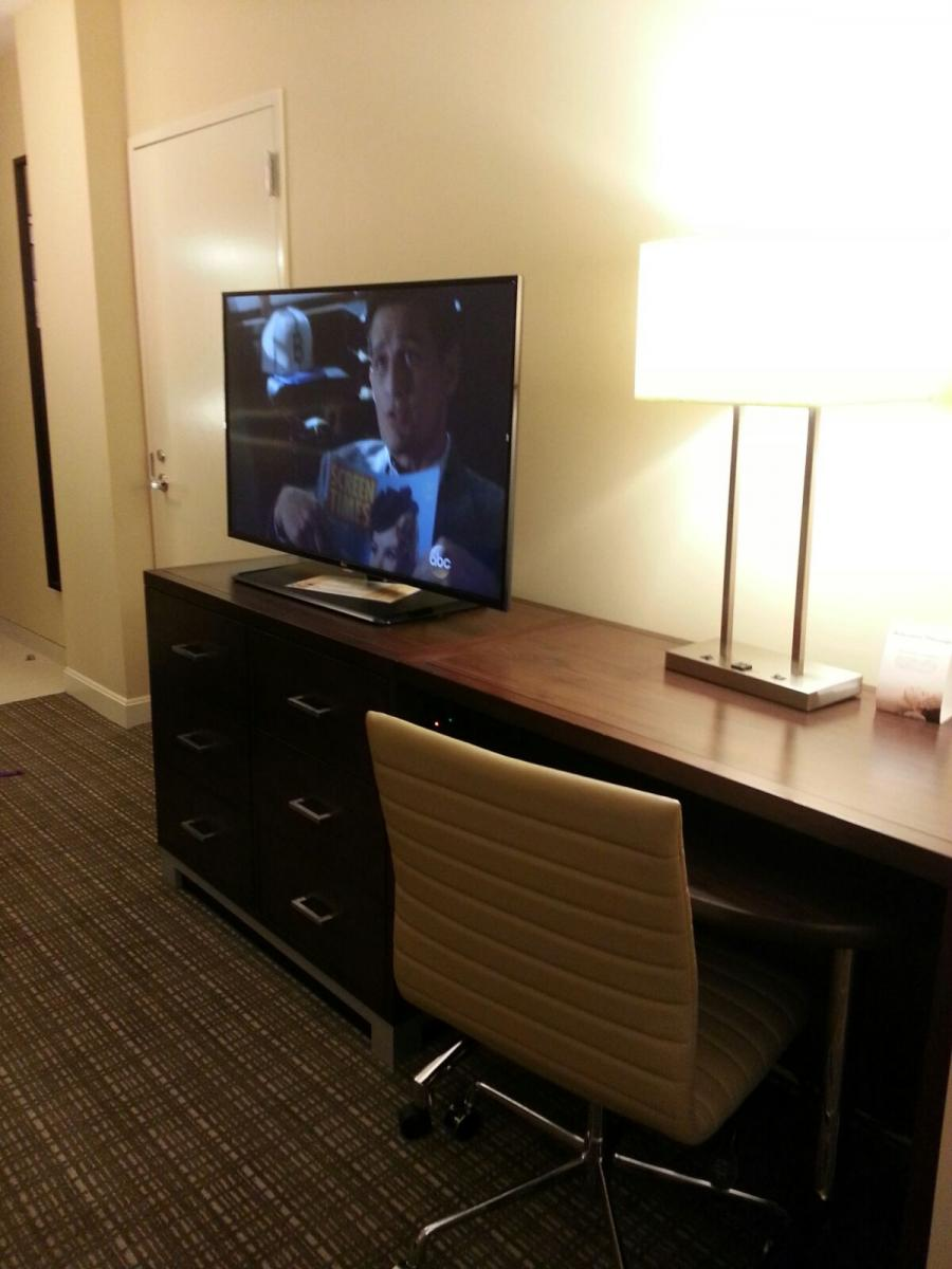 Office desk, office chair and TV at Rotary House International Hotel, MD Anderson