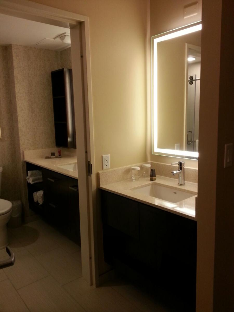 MD Anderson Rotary House International Hotel bathroom with 2 sinks