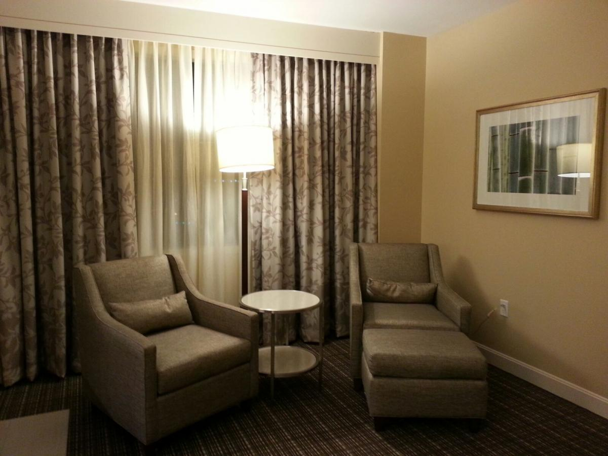 MD Anderson Rotary House arm chairs and side table
